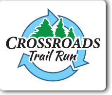 running green at crossroads logo